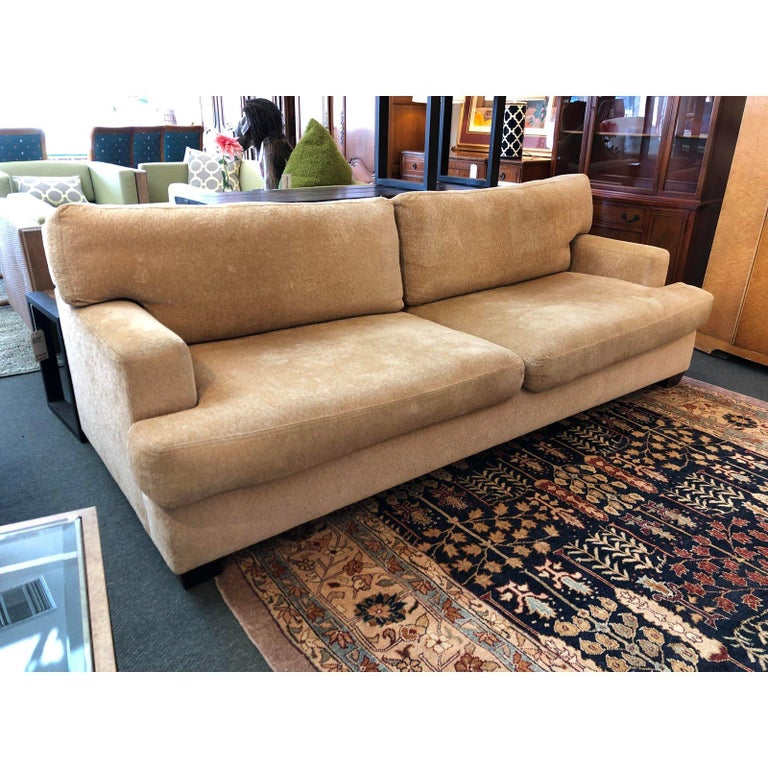 96 inch lounging sofa. Simple lines softened with down-wrapping and textured upholstery. Made in LA, handcrafted, FSC Certified Wood, Goose Feathers & Down, Low-Voc Stains,    Measures: Seat height 18 inches Arm height 23 1/2 inches.