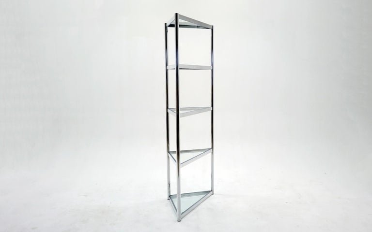 Tall glass and chrome triangular corner display / etagere in the style of Milo Baughman. Five Shelves including the top.
