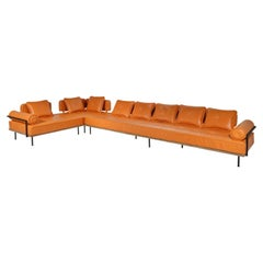Corner Leather Sofa in Reclaimed Hardwood and Sand Cast Brass, by P. Tendercool
