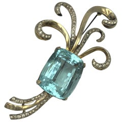 Corocraft Sterling deco gold plated brooch with faux table cut aquamarin 1943's