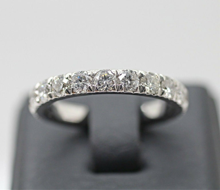Corona 18k white gold diamond eternity ring 1.50cts. ring size is 6.25 containing, Specifications:     main stone: ROUND DIAMONDS     diamonds: 17 PIECES     carat total weight: APPROXIMATELY 1.50     color: F     clarity: SI2     brand: CUSTOM