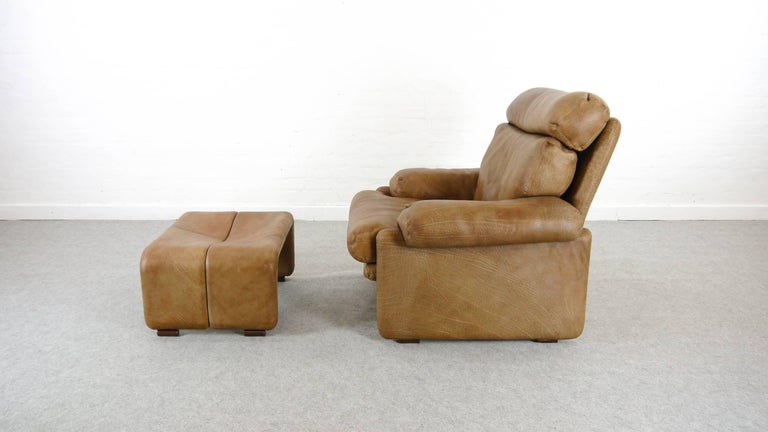 Extreme comfortable midcentury highback chair model: Coronado with matching footrest. Design by Tobia & Afra Scarpa 1966. Manufactured by B&B Italia, Italy. Upholstered in original thick brown leather with a slight and nice patination. Marked with