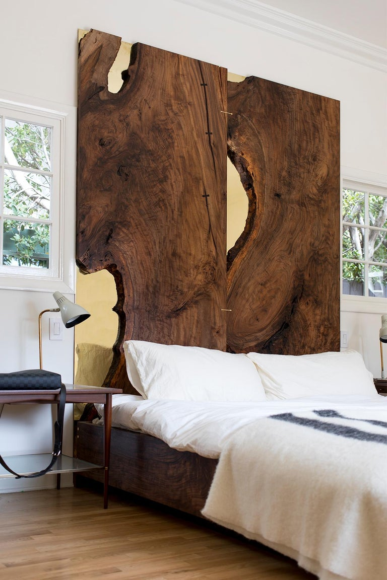 Handcrafted from two solid slabs of California Bastogne walnut with polished brass mirrored inlays that reflect those that pass by, the Corset Bed features uncompromising detail and materiality. The bed frame is cut from remnants of the two vertical