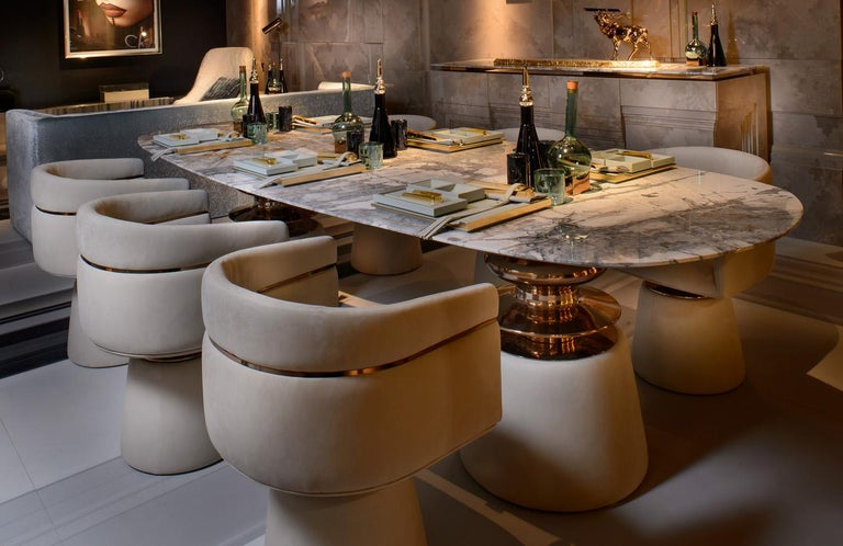 A group of people with diverse specialized skills bonded by the single objective of bringing design beauty. This is the founding idea of CLAN. This philospy is reflected on the CORTES dining table. A piece with diffent element and materials that