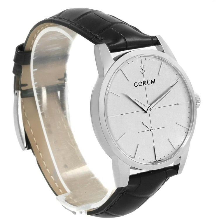 Corum Heritage 38mm Silver Dial Steel Mens Watch V157/02614. Manual-winding movement. Stainless steel case 38.0 mm in diameter. Exhibition sapphire crystal caseback. Fixed stainless steel bezel. Scratch resistant sapphire crystal. Silver dial with