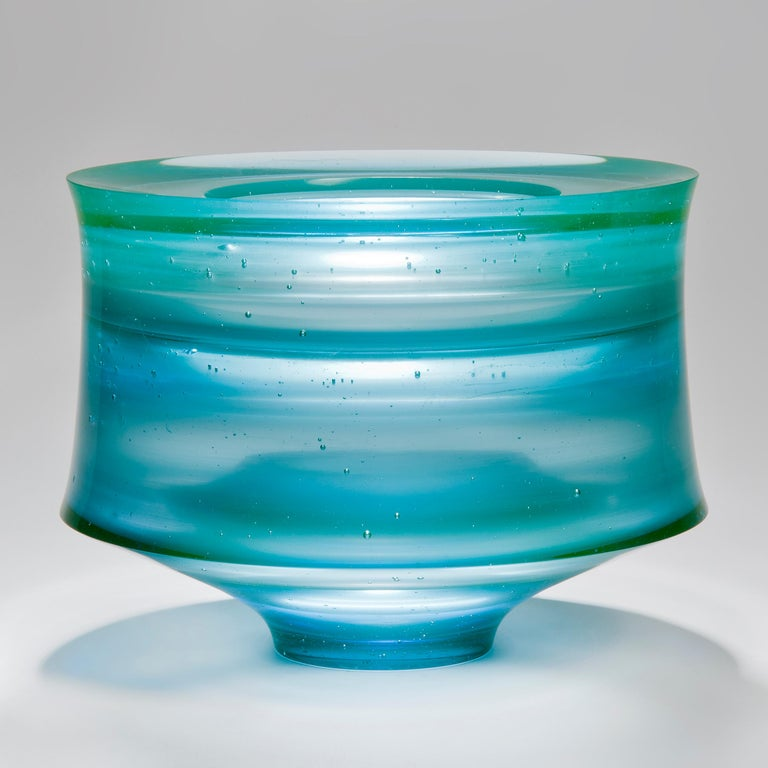 Corymb is a cast glass artwork in a beautiful soft aqua / turquoise blue by the British artist Paul Stopler. With a smooth exterior, the interior is stepped into sections by ridged protruding