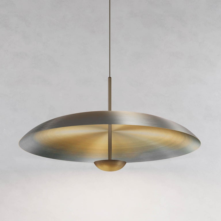 Two finely hand-spun brass plates make up this pendant light, a bronze to brass gradient accentuates the shape. The light is projected into the shade and reflects out, illuminating without creating a glare. 