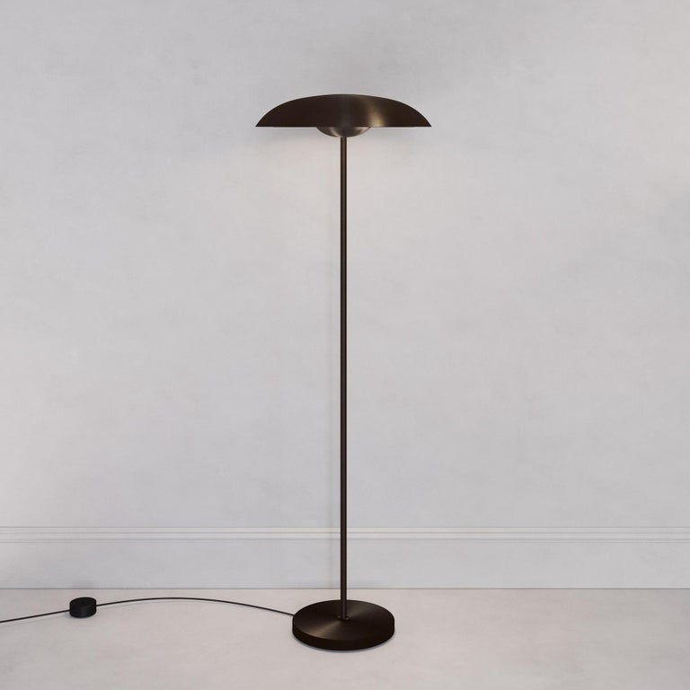 A gentle silhouette of plates makes up this unique floor lamp. Composed by dark bronze gradient patinated brass plates and finely brushed dark bronze framework, the Solstice Noir X floor light is softly illuminated with integrated LED elements from