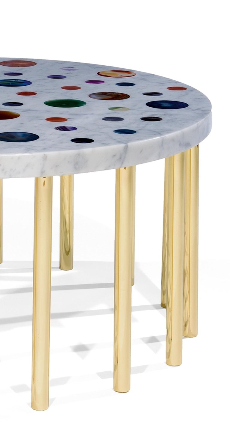 'Cosmos' coffee table in Carrara marble with agate disks of different colors and with sixteen brass legs designed and produced by Studio Superego in 2017.  Superego editions was born in 2006, performing a constant activity of research in