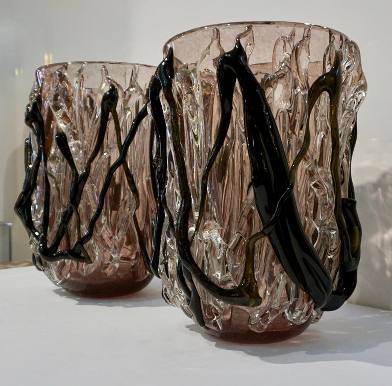 2000s Venetian modern sculpture pair of large high quality Murano glass vases, the clear glass body with exceptional decoration, worked internally with light purple spotted inclusions, in the manner of Ercole Barovier, is wrapped in organic crystal