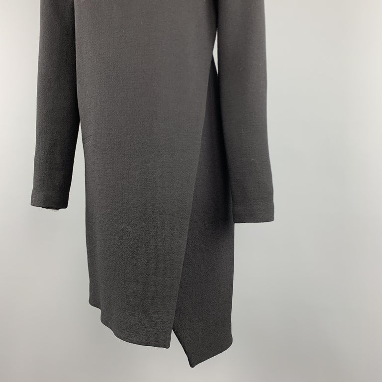 COSTUME NATIONAL dress comes in wool crepe with a V neck, long sleeves, and faux wrap motif. Silk lined. Made in Italy.  Excellent Pre-Owned Condition. Marked: IT 40  Measurements:  Shoulder: 14.5 in. Bust: 36 in. Waist: 34 in. Hip: 38 in. Sleeve: