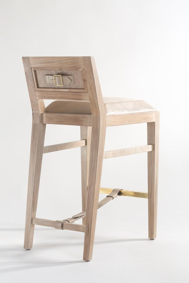 The solid walnut counter stool is handcrafted with traditional joinery. Shown in a combination of leather and fabric upholstery. This is a homage to 1940s French designer Jacques Adnet. Custom sizes and finishes available.