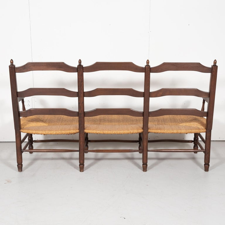 Country French Ladder-Back Walnut Settee or Radassier with Rush Seat For Sale 12