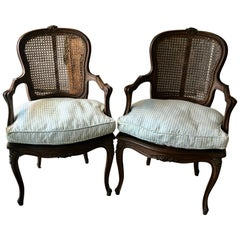 Country French Pair of Carved Walnut and Caned Armchairs