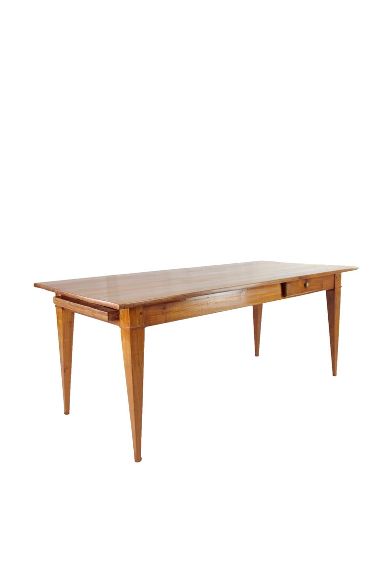 France, circa 1830-1840 Massive cherry tree Sharp running up square legs At the side a drawer Restored state, wax polish Measures: Height 77 cm, length 191 cm, depth 88 cm  Delivery can be made to your door within 7 days worldwide. We already