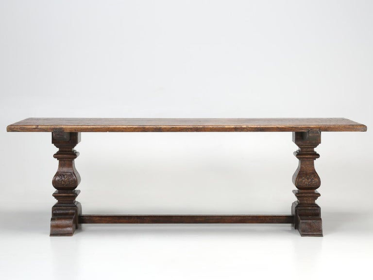 Country Italian trestle dining table, constructed from solid elmwood. Since our Country Italian style farm table, had been previously restored, prior to our purchase, there is little way for us to determine the Italian dining tables true age.