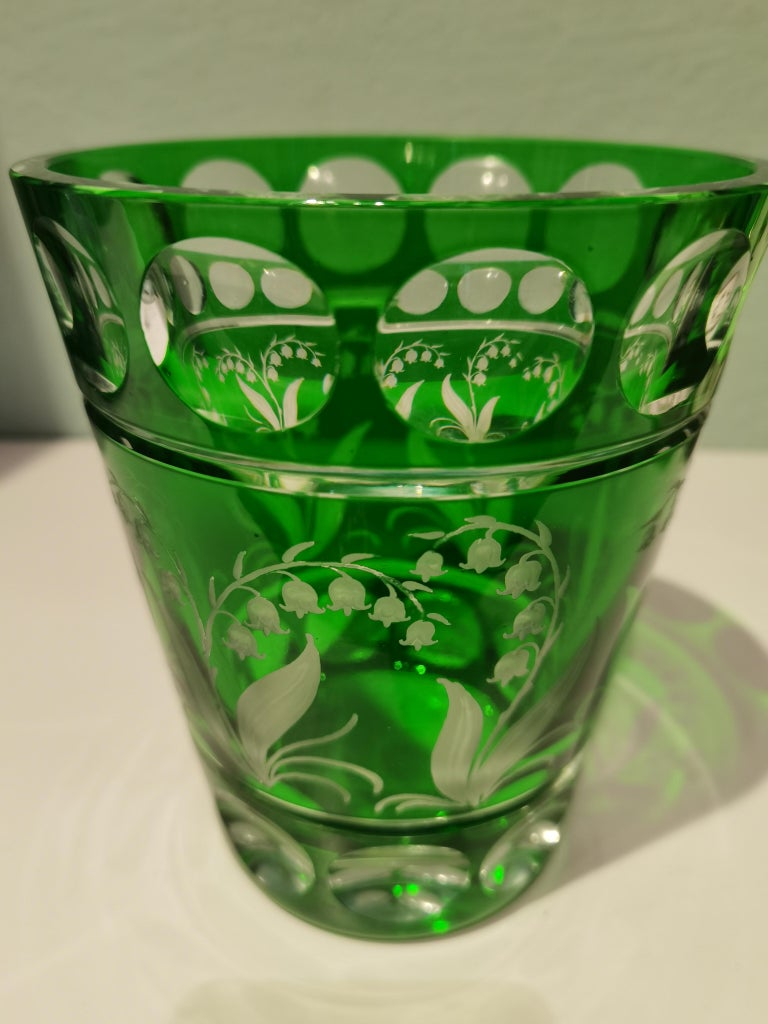 Hand blown crystal vase in green with a hand-engraved lily of the valley decor all-around in a country style. Entirely handmade crystal glass. Hand blown and hands-free engraved in Bavaria Germany. The crystal here shown comes in a light green and