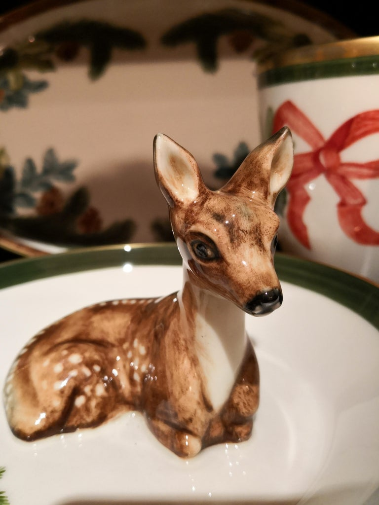 Completely handmade porcelain bowl with a hands-freenaturalistic painted bambi figure in brown in country style. The bambi is sitting in the middle of the bowl for decorating nuts or sweets around. Rimmed with a fine 24-carat gold line. Handmade in