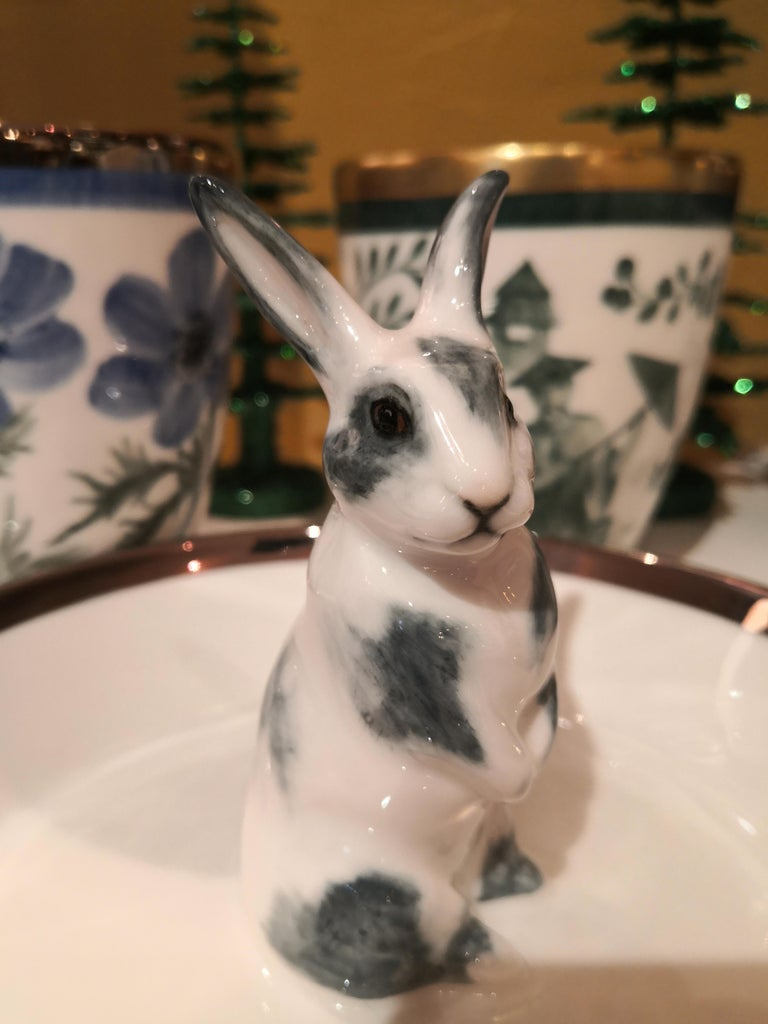 Completely handmade porcelain bowl with a hands-free naturalistic painted bunny figure with grey spots in country style. The bunny is sitting in the middle of the bowl for decorating nuts or sweets around. Rimmed with a platinum line. Handmade in