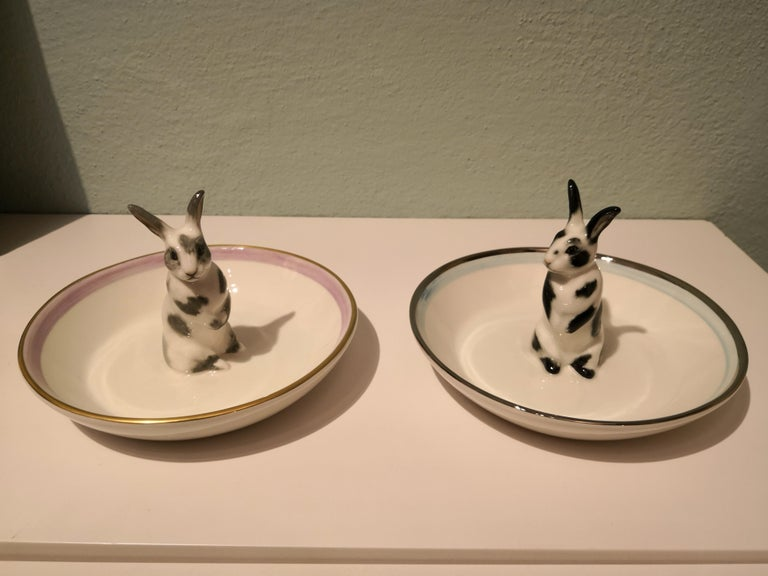 Completely handmade porcelain bowl with a hands-free naturalistic painted hare figure with black spots. The bunny is sitting in the middle of the bowl for decorating nuts or sweets around. Rimmed with a pale blue and platinum line. Handmade in