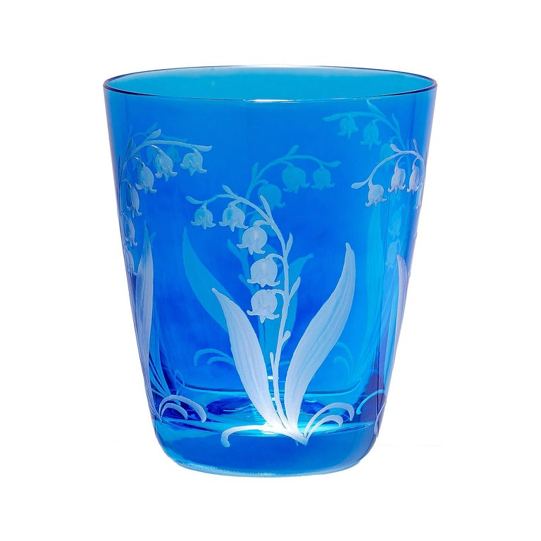 Set of six hand blown tumbler in blue crystal with a hand-edged country style decor. The decor shows a hand-engraved decor lily of the valley all-over the glass. Handmade in Bavaria/Germany. Can be ordered in different colors like green blue and