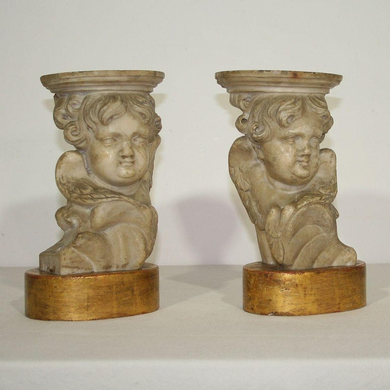 Spectacular and unique couple of 17th-18th century hand carved marble angels once mounted on these giltwood pedestals Italy, circa 1650-1750. Weathered, small losses. More pictures are available on request.