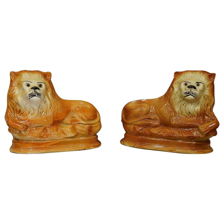 Couple of English Cinnamon Ceramic Lions Staffordshire Manufacture, Crystal Eyes For Sale