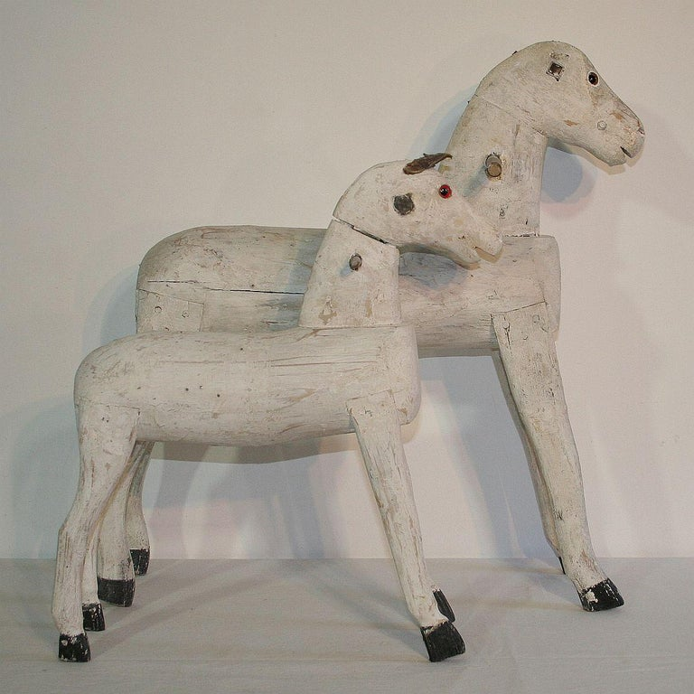 Unique pair of 19th century French painted wooden horses with a beautiful patina, France, circa 1850-1900.