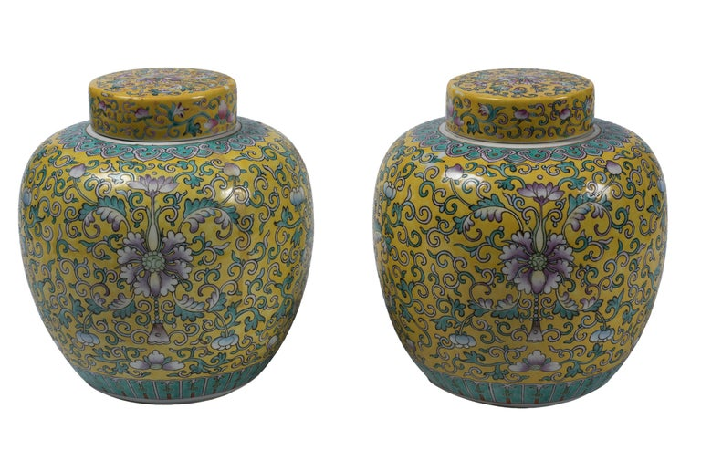 Couple of ginger pots is an elegant set of Chinese pots with yellow background and green and blue decorations.