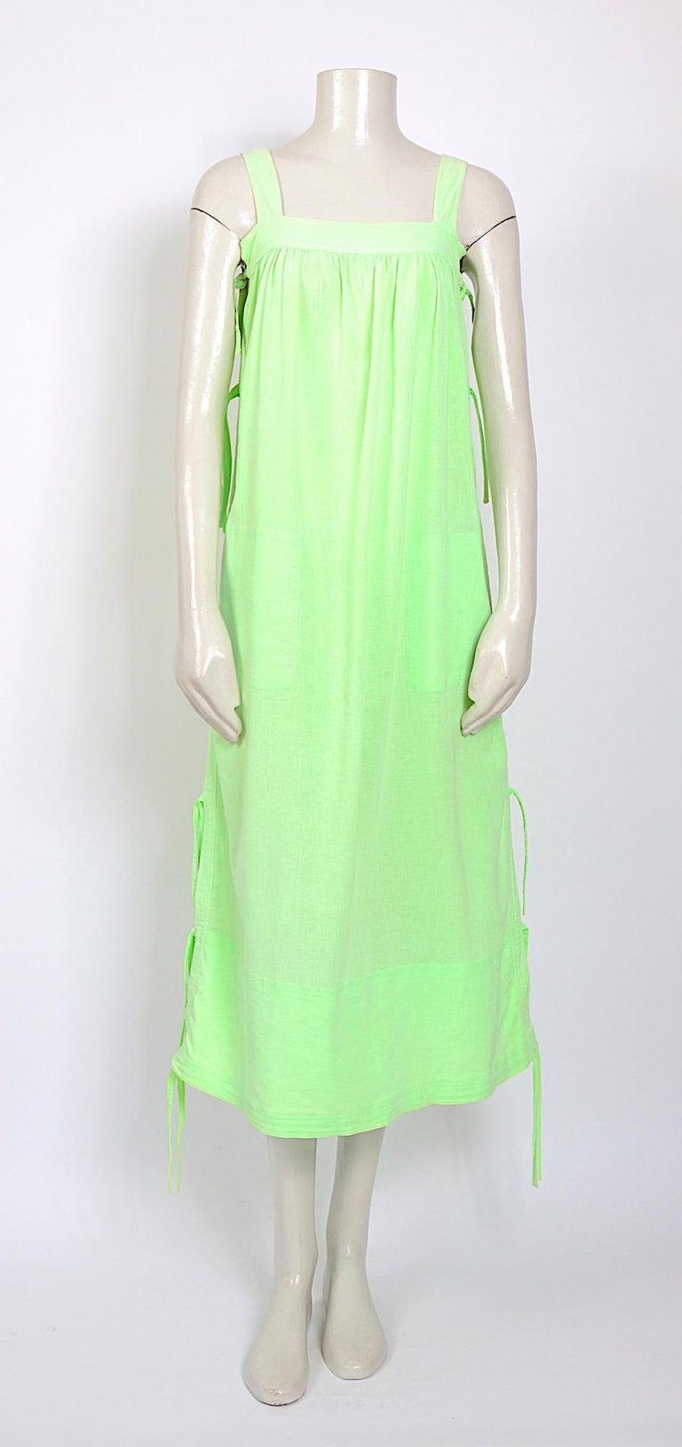 Andre Courreges vintage 1970s cotton bright lime green cotton linen summer dress  Courreges size 00 Measurements taken flat: Ua to Ua 16,5inch/42cm (x2)- Waist 25inch/64cm(x2) - Total length with strap 48inch/122cm