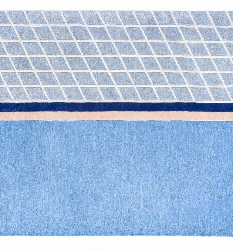 """The """"Court Series"""" rugs are hand-tufted with blended wool and viscose material dyed in hyper-saturated colors, with tennis court-like geometries represented both via overlaid graphics as well as the cut and shape of individual segments. Designed by"""