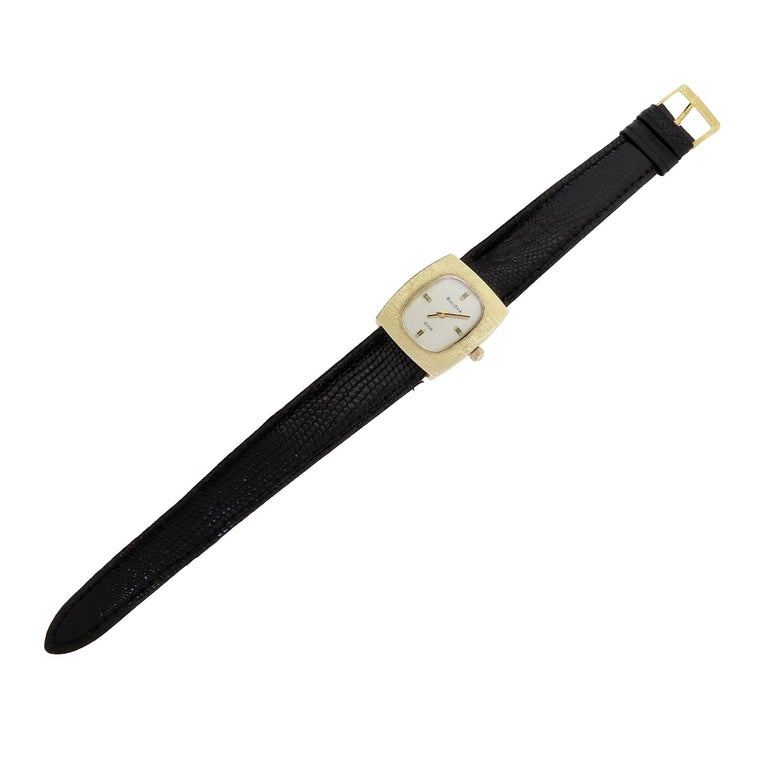 Vintage late 1960s couture ladies watch by Bulova for Christian Dior. Features a solid 14K yellow gold case and crown complemented by a minimalist white dial with gold hand and index accents. This timeless and elegant design by Dior has become