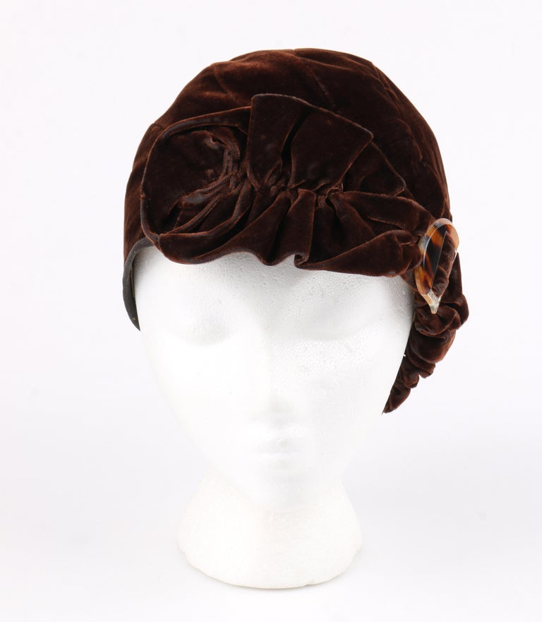 COUTURE c.1920's Dark Brown Ruffle Tortoiseshell Crystal Deco Embellishment Velvet Cloche Hat   Circa: 1920's  Style: Hat Color(s): Brown Lined: Yes  Unmarked Fabric Content (feel of): velvet (exterior); silk (lining) Additional Details /
