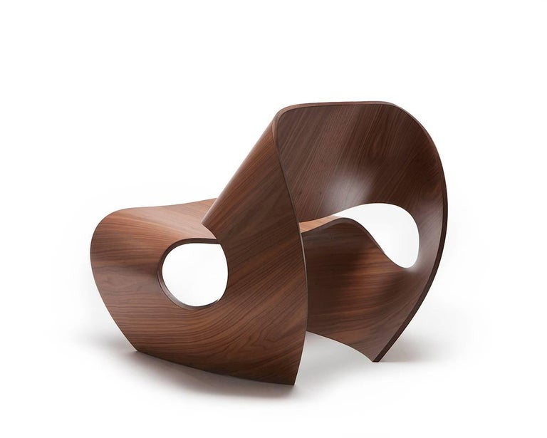 The contemporary Cowrie chair is a rock solid easy chair inspired by the concave lines of sea shells. The curvilinear forms are the result of an extensive research and innovation process that bridges the handmade with the digital. Sweeping lines are