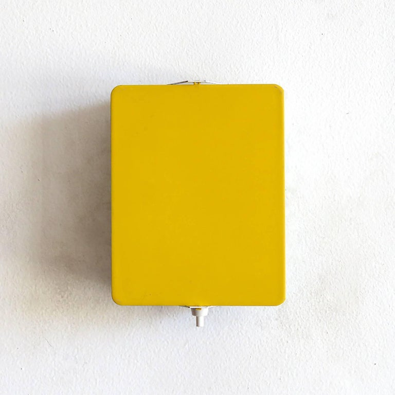 Iconic enameled wall lights by Charlotte Perriand with adjustable reflectors in rare yellow finish, optional horizontal or vertical mount, manufactured and distributed by Steph Simon, Paris, marked, wired for US standards, one E12 socket per light,
