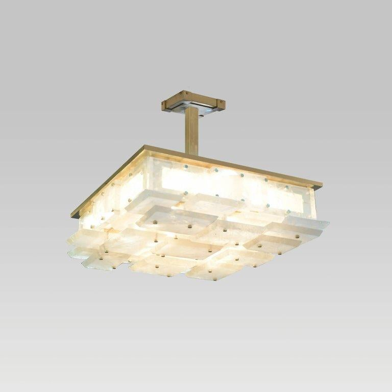 A modern rock crystal semi flush mount with multiple panels decorations, polish brass mount. Created by Phoenix Gallery NYC. Custom size available. Antique brass and nickel plating optional. High can be adjustable.
