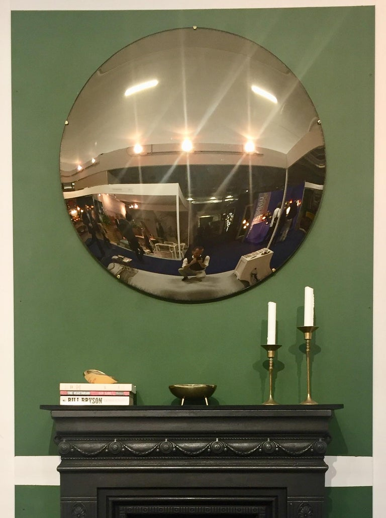 Handcrafted frameless bronze tinted convex mirror.  Each Orbis convex mirror is handcrafted. Slight variations in dimensions, tint and finish are characteristics of such handcrafted work. These characteristics enhance the beauty of the mirrors and