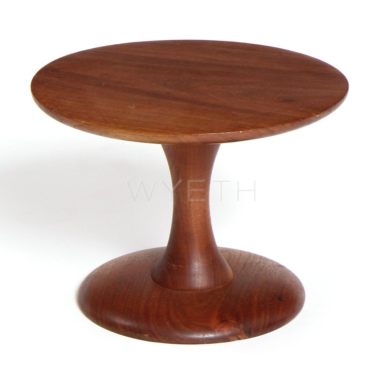 A small walnut turned pedestal or children's stool.