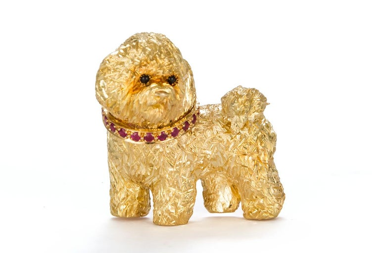 We are pleased to offer this Craig Drake 18k Yellow Gold & Ruby Dog Brooch. The brooch features a cute little dog fashioned from 18k Yellow Gold accented by an estimated 0.75ctw Round Brilliant Cut Rubies. The brooch measures approximately 1.25