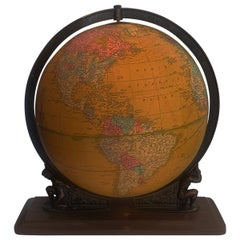 Crams Illuminated World Terrestrial Globe sitting on the shoulders of Atlas