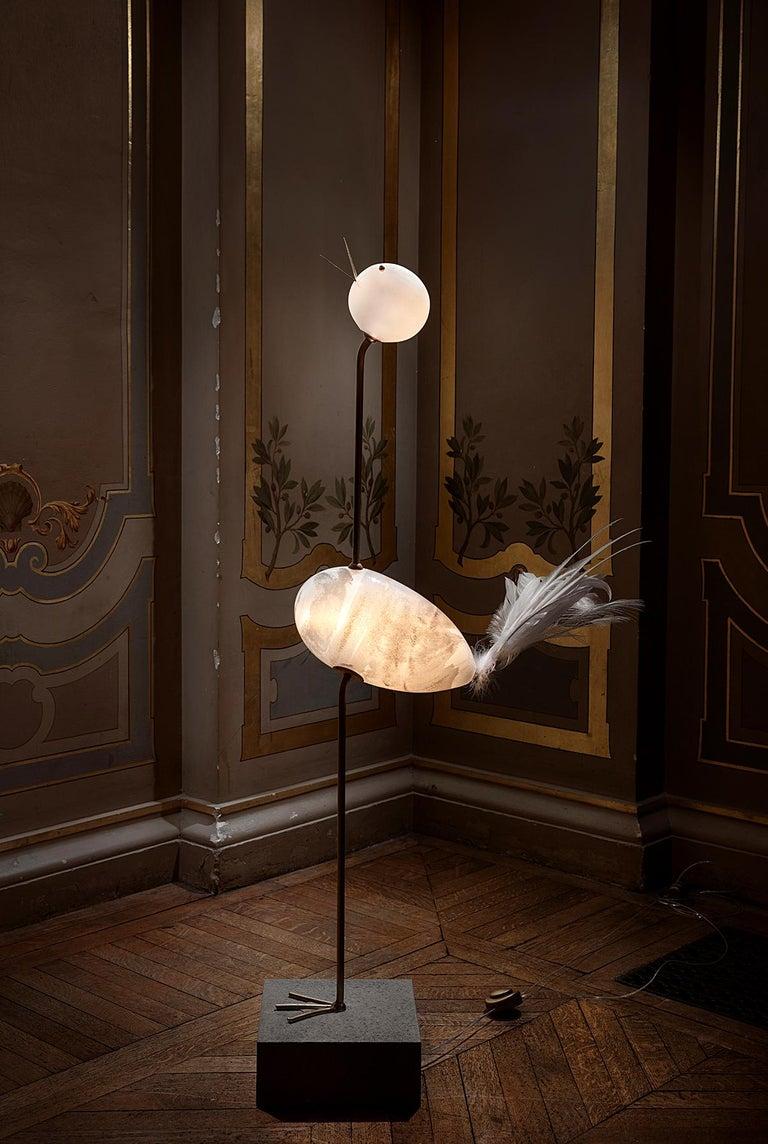 Crane, unique floor lamp sculpture, Ludovic Clément d'Armont Blown glass, textile, brass Dimensions: 125 x 55 x 25 cm   Ludovic Clément d'Armont is in the continuation of a family tradition of centuries of gentle glassmakers, painters,