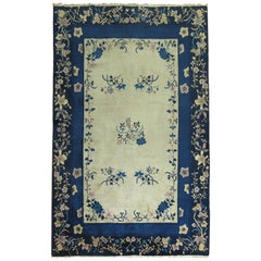 Cream and Blue Chinese Rug