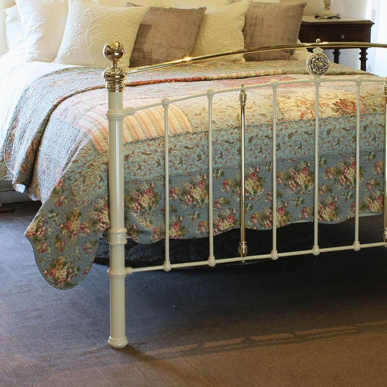 Antique bed in cream with convex brass top rail, decorative central brass castings and brass kneecaps.  This bed accepts a UK King size or US Queen size (5ft, 60in or 150cm wide) base and mattress set.  The price is for the bed frames alone. The