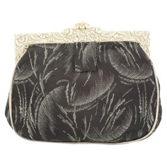Cream carved Bakelite frame and patterned silk clutch bag, English, 1920s