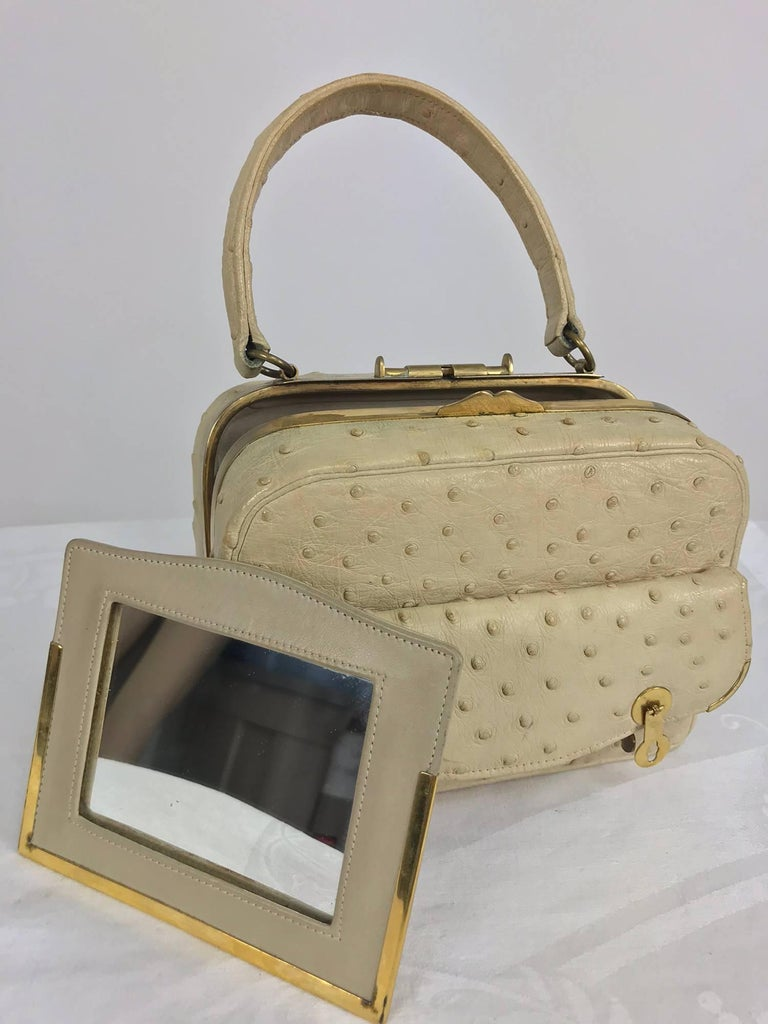 Cream ostrich leather frame handbag from the 1960s with gold hardware. This is a beautifully made handbag, I can't believe it doesn't have a label or stamp inside! The bag is made from soft ostrich leather in cream, it has a lovely patina. At the
