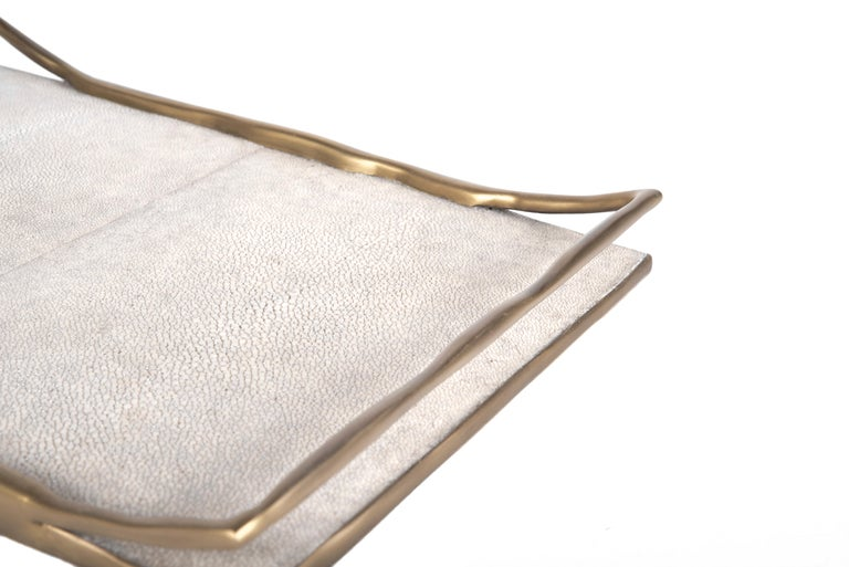 The melting tray comes in two sizes and two color variants. This listing is for the medium size in cream shagreen. The irregular surfaced bronze-patina brass handles, frame the tray in a beautiful & sculptural way.  Measures: Large 58.5 x 34.5 x