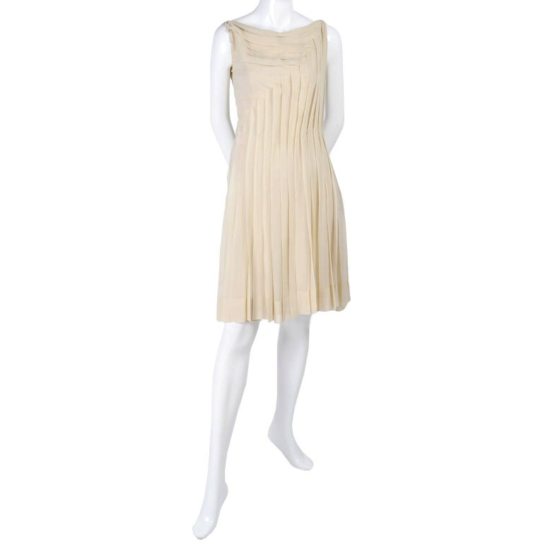 This is one of our favorite vintage dresses of all time! This exceptional nude silk dress came from an estate of nothing but Chanel, Valentino, Hermes, Yves Saint Laurent and Givenchy vintage clothing.  She had only the very best and many pieces