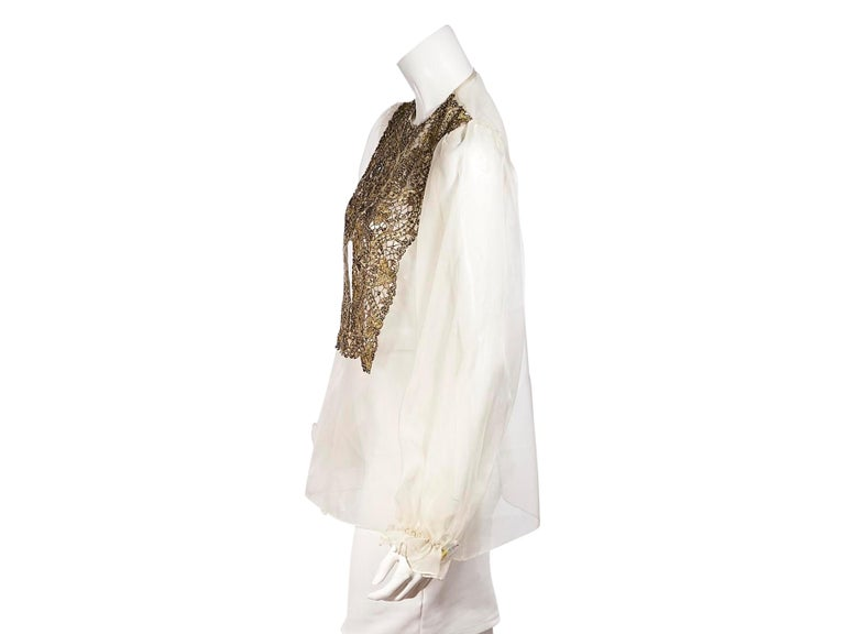 Product details:  Vintage cream silk bead-embellished blouse by Oscar De La Renta.  Scoop-neck. Long blouson sleeves. Concealed snap button front closure. Pair yours with a tweed midi-skirt. Label size 8. 38