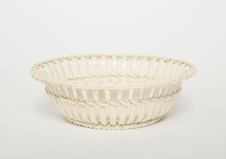 Antique Wedgwood creamware chestnut basket in very good condition.  This basket for today's use would be great filled with cherries, strawberries or grapes.  There are no chips or cracks.  (This item is eligible for a gift box upon request)