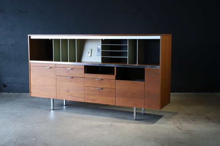 The double decker of credenzas. Designed by George Nelson for Herman Miller. Doors, drawers, shelves, lights, storage and even a hidden trash can, everything you need to keep your office in order. Pictured with a diamond chair by Harry Bertoia and
